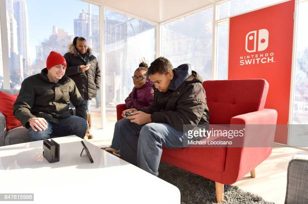 In this photo provided by Nintendo of America locasl fans in Madison Square Park play the 12Switch game in tabletop mode in Madison Square Park in...