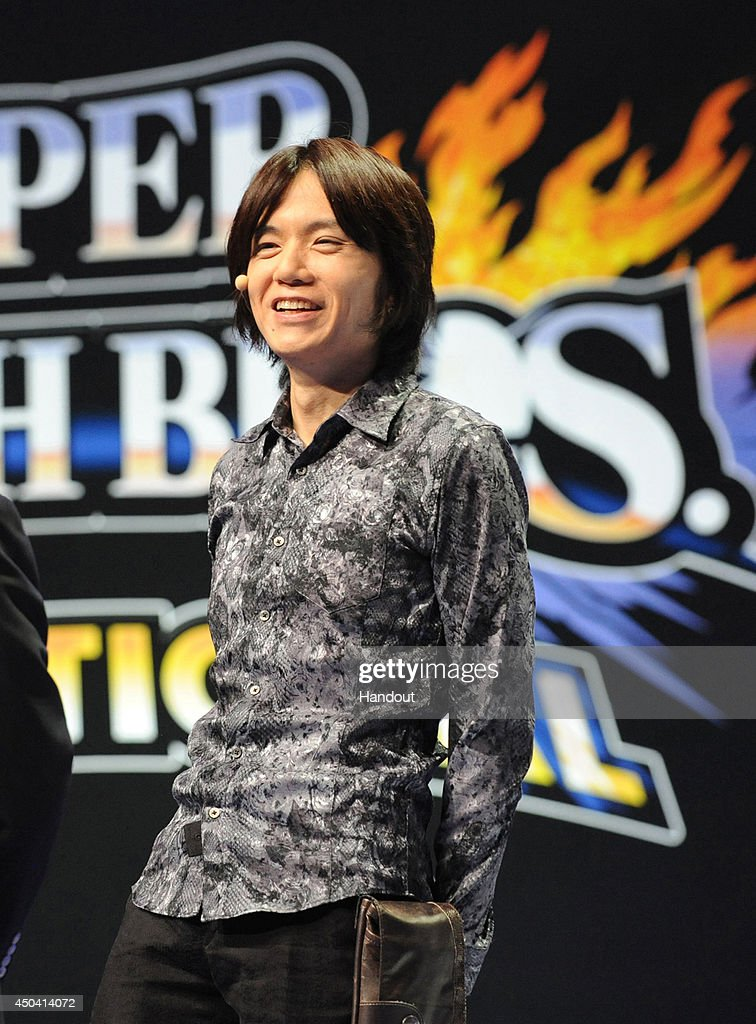 In this photo provided by Nintendo of America, Masahiro Sakurai, creator and director of Nintendo's Super Smash Bros. series, welcomes the excited crowd at NOKIA Theatre L.A. LIVE and fans watching online to the Super Smash Bros. Invitational tournament at the E3 video game trade show on June 10, 2014 in Los Angeles, California.