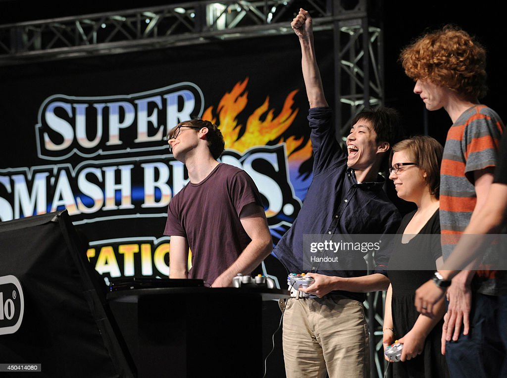 In this photo provided by Nintendo of America, Masaya 'Amsa' Chikamoto of Japan (2nd L) celebrates a victory in a multiplayer battle during the Super Smash Bros. Invitational tournament at NOKIA Theatre L.A. LIVE on June 10, 2014 in Los Angeles, California. The Invitational is to celebrate the upcoming launches of Nintendo's Super Smash Bros. video games for Nintendo 3DS and Wii U.