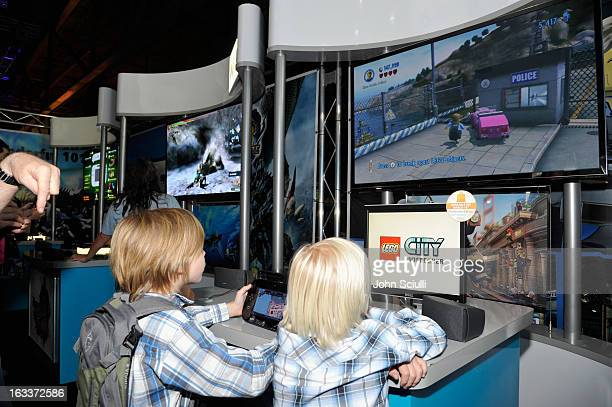 In this photo provided by Nintendo of America Rutger and Jaeger from Austin Texas play LEGO City Undercover for Wii U at Nintendo's booth at the SXSW...