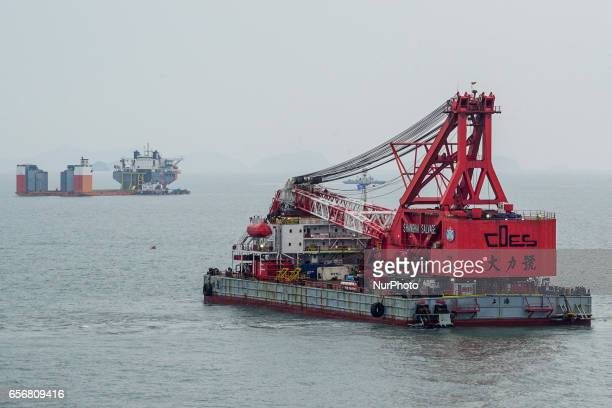 In this photo provided by South Korean Maritime Ministry a giant crane prepares to attempt to salvage the sunken Sewol ferry in waters off Jindo...