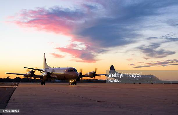 In this photo provided by the Australian Defence Department a Royal New Zealand Air Force P3K2 Orion aircraft arrives March 18 2014 at RAAF Base...