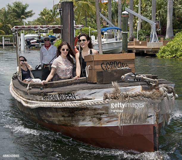 In this photo provided by the Florida Keys News Bureau actresses Olivia Thirlby and Carly Pope ride the original African Queen on May 3 2014 in Key...