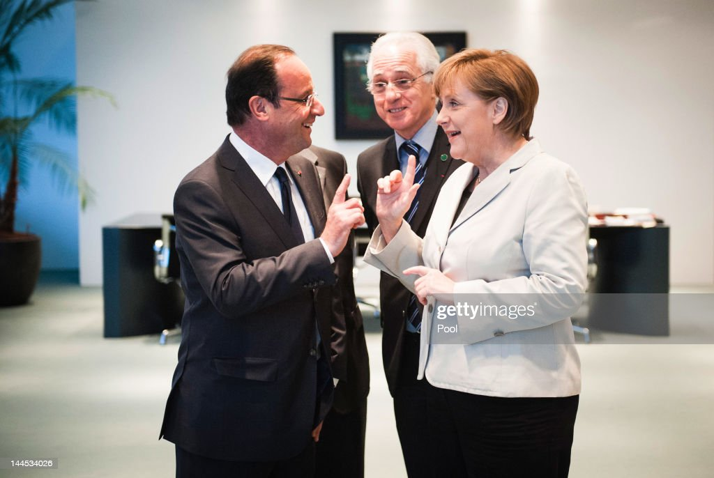 In this photo provided by the German Government Pres Office (BPA), German Chancellor <a gi-track='captionPersonalityLinkClicked' href=/galleries/search?phrase=Angela+Merkel&family=editorial&specificpeople=202161 ng-click='$event.stopPropagation()'>Angela Merkel</a> speaks with new French President Francois Hollande at the Chancellery hours after Hollande's inauguration in Paris on May 15, 2012 in Berlin, Germany. Hollande has come to Berlin to discuss the current European debt crisis with Merkel and most importantly to find common ground, as he hopes to resolve the crisis with measures that mark a departure from the austerity packages favoured by Merkel. (Photo by Jesco Denzel/Bundesregierung-Pool via Getty Images
