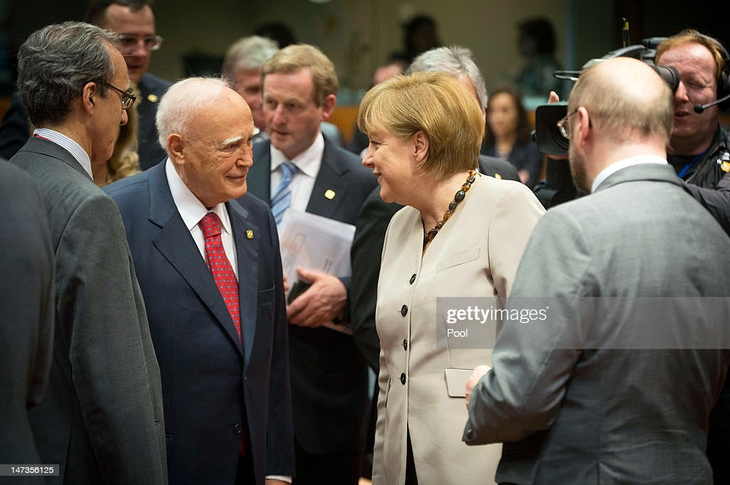 In this photo provided by the German Government Press Office (BPA), Chancellor Angela Merkel and Greek President Karolos Papoulias are interviewed by President of the European Parliament, Martin Schulz (R), during the kick-off of the Meeting of the European Council at the EU Council building on June 28, 2012 in Brussels, Belgium. Econimic issues expected to be discussed during the two-day European Council meeting, 28-29 June are the Multiannual Financial Framework, the European Semester and the European growth agenda.