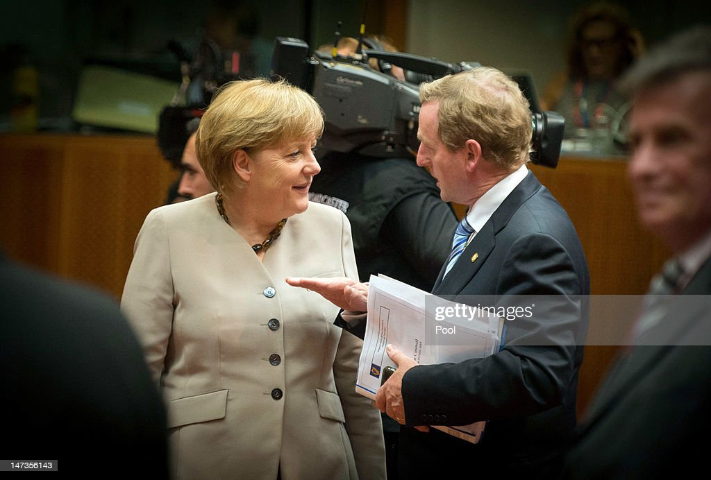 In this photo provided by the German Government Press Office (BPA), Chancellor <a gi-track='captionPersonalityLinkClicked' href=/galleries/search?phrase=Angela+Merkel&family=editorial&specificpeople=202161 ng-click='$event.stopPropagation()'>Angela Merkel</a> speaks with Irish Prime Minister <a gi-track='captionPersonalityLinkClicked' href=/galleries/search?phrase=Enda+Kenny&family=editorial&specificpeople=5129605 ng-click='$event.stopPropagation()'>Enda Kenny</a> during the opening session of the Meeting of the European Council at the EU Council building on June 28, 2012 in Brussels, Belgium. Econimic issues expected to be discussed during the two-day European Council meeting, 28-29 June are the Multiannual Financial Framework, the European Semester and the European growth agenda.