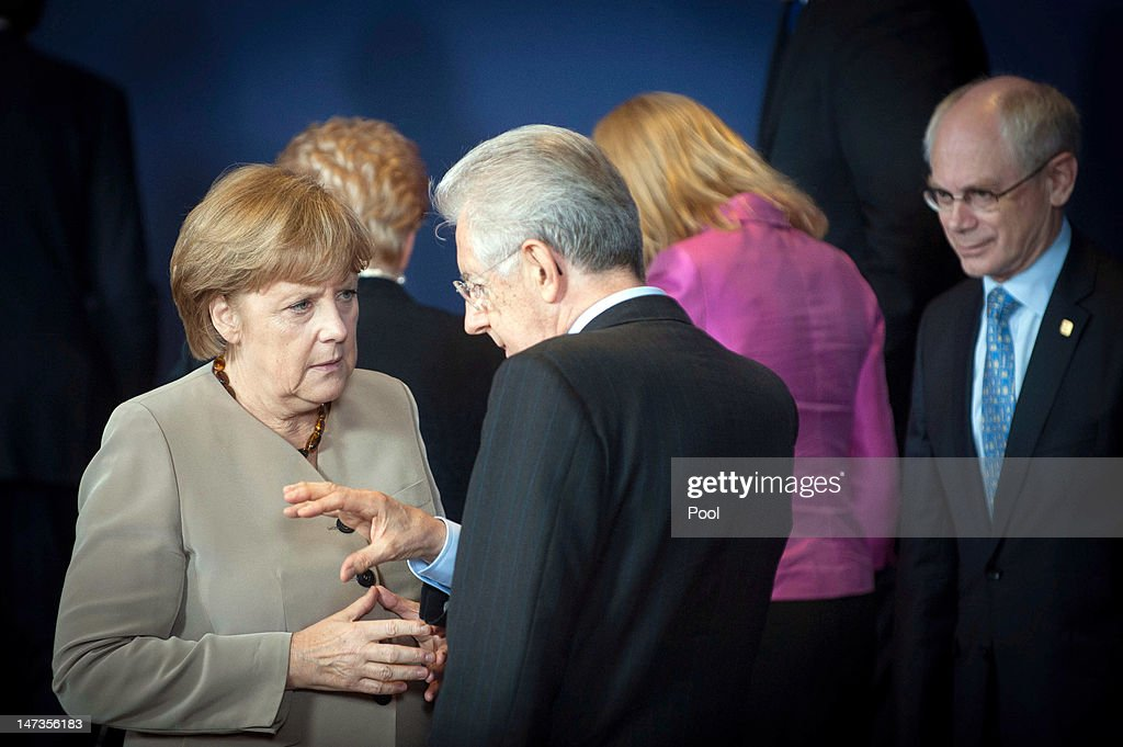 In this photo provided by the German Government Press Office (BPA), Chancellor Angela Merkel speaks with Italian Prime Minister Mario Monti, as President of the European Council, Herman Van Rompuy looks on, during the opening session of the Meeting of the European Council at the EU Council building on June 28, 2012 in Brussels, Belgium. Econimic issues expected to be discussed during the two-day European Council meeting, 28-29 June are the Multiannual Financial Framework, the European Semester and the European growth agenda.