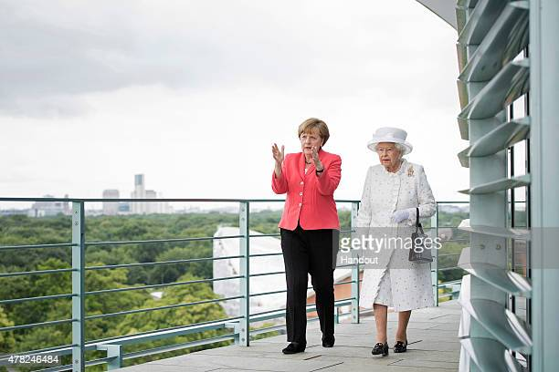 In this photo provided by the German Government Press Office Angela Merkel welcomes Queen Elizabeth II upon her arrival at the Federal Chancellery on...