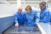 In this photo provided by the German Government Press Office Professor KarlHeinz Büttner head of the Siemens plant in Amberg and Joe Kaeser CEO of...