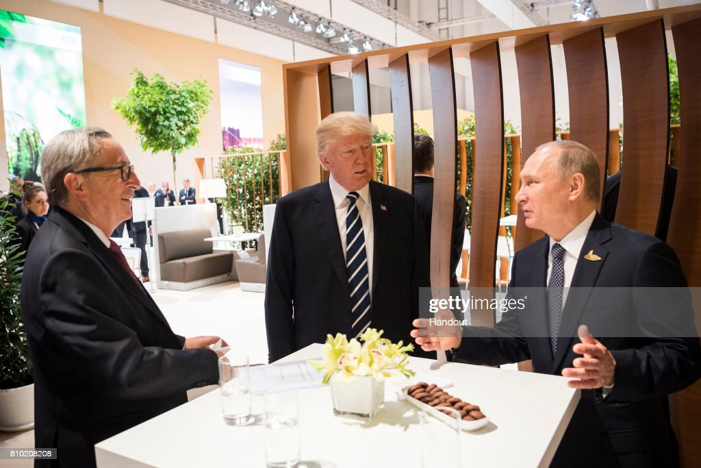In this photo provided by the German Government Press Office (BPA), Donald Trump, President of the USA (C) meets Vladimir Putin, President of Russia and President of the EU Commission Jean-Claude Juncker (L) during the G20 Summit on July 7, 2017 in Hamburg, Germany. The G20 group of nations are meeting July 7-8 and major topics will include climate change and migration.