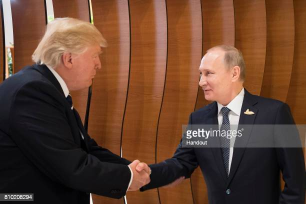 In this photo provided by the German Government Press Office Donald Trump President of the USA meets Vladimir Putin President of Russia at the...