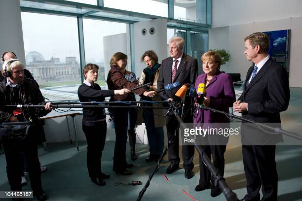 In this photo provided by the German Government Press Office German Chancellor Angela Merkel German Vice Chancellor and Foreign Minister Guido...