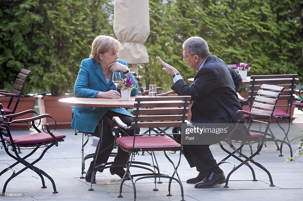 In this photo provided by the German Government Press Office German Chancellor <a gi-track='captionPersonalityLinkClicked' href=/galleries/search?phrase=Angela+Merkel&family=editorial&specificpeople=202161 ng-click='$event.stopPropagation()'>Angela Merkel</a> talks to Amre Moussa, Secretary General of the League of Arab States, during a meeting on the rooftop terrace of the Chancellery (Bundeskanzleramt) on May 10, 2011 in Berlin, Germany.