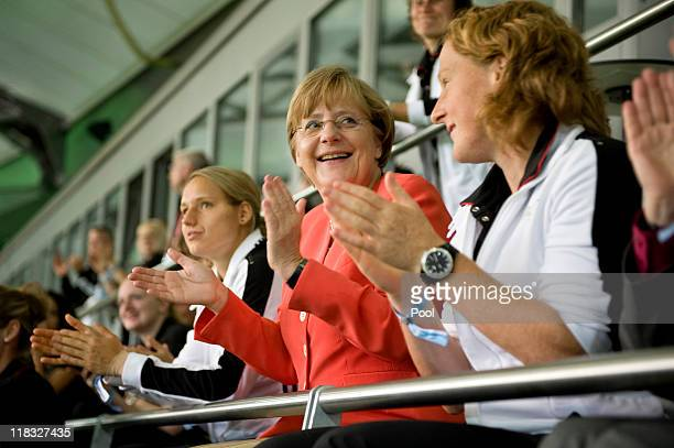 In this photo provided by the German Government Press Office German Chancellor Angela Merkel watches the match with the German Women national team...