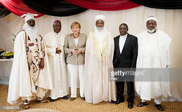 In this photo provided by the German Government Press Office German Chancellor Angela Merkel poses with representatives of religious communities emir...