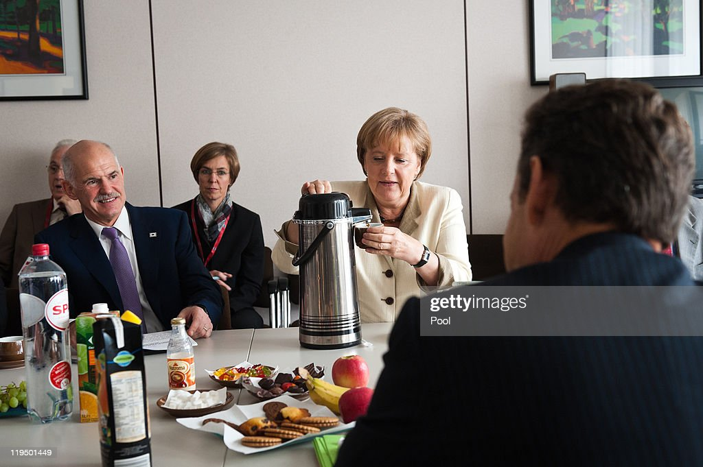 In this photo provided by the German Government Press Office German German Chancellor Angela Merkel talks to Greek Prime Minister George A Papandreo...