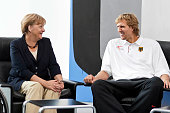 In this photo provided by the German Government Press Office German Chancellor Angela Merkel chats with Dirk Nowitzki of Germany during a reception...