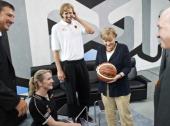In this photo provided by the German Government Press Office German Chancellor Angela Merkel chats with Dirk Nowitzki of Germany wheelchair...