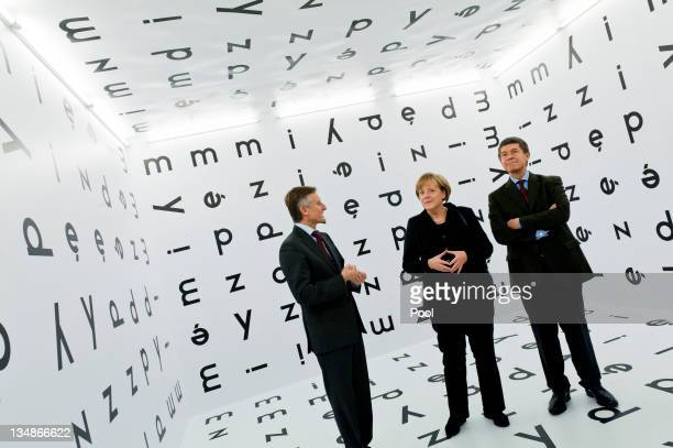 In this photo provided by the German Government Press Office German Chancellor Angela Merkel views a concrete poetry installation by Polish artist...