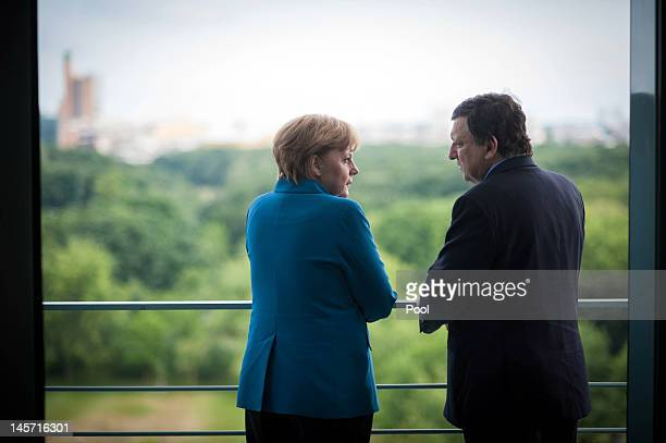 In this photo provided by the German Government Press Office German Chancellor Angela Merkel speaks with EU Commissioner Jose Manuel Barroso at the...