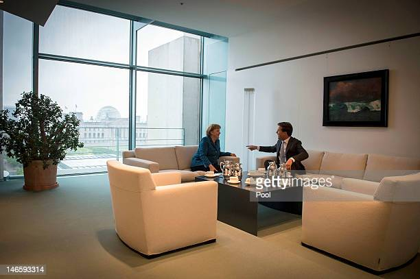 In this photo provided by the German Government Press Office German Chancellor Angela Merkel meets with the Dutch Prime Minister Mark Rutte at the...