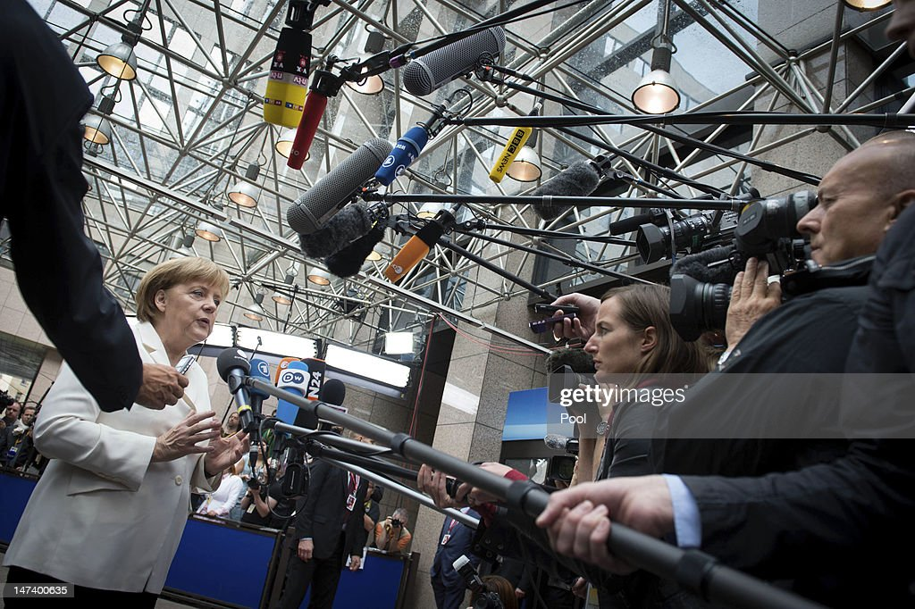 In this photo provided by the German Government Press Office (BPA), German Chancellor <a gi-track='captionPersonalityLinkClicked' href=/galleries/search?phrase=Angela+Merkel&family=editorial&specificpeople=202161 ng-click='$event.stopPropagation()'>Angela Merkel</a> speaks to media as she arrives for a second day of the European Union leaders summit on June 29, 2012 on June 28, 2012 in Brussels, Belgium. Econimic issues expected to be discussed during the two-day European Council meeting, 28-29 June are the Multiannual Financial Framework, the European Semester and the European growth agenda.