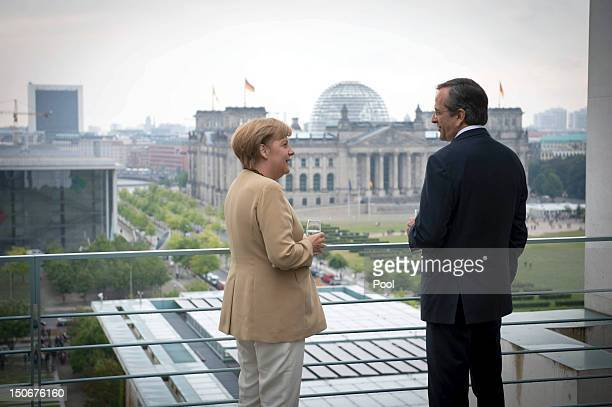 In this photo provided by the German Government Press Office German Chancellor Angela Merkel and Greek Prime Minister Antonis Samaras talk at the...