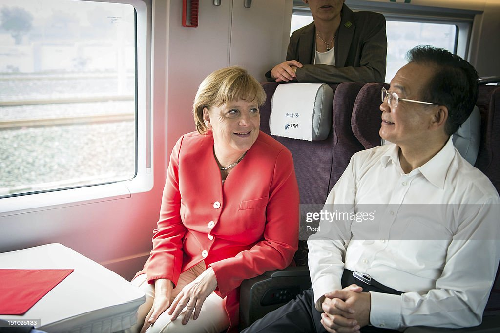 In this photo provided by the German Government Press Office, German Chancellor <a gi-track='captionPersonalityLinkClicked' href=/galleries/search?phrase=Angela+Merkel&family=editorial&specificpeople=202161 ng-click='$event.stopPropagation()'>Angela Merkel</a> and the Chinese Premier <a gi-track='captionPersonalityLinkClicked' href=/galleries/search?phrase=Wen+Jiabao&family=editorial&specificpeople=204598 ng-click='$event.stopPropagation()'>Wen Jiabao</a> travel on the high-speed train from Beijing to Tianjin. Chancellor Merkel is on a two day visit during which she has led several ministers and a high-powered business delegation into her second visit to China this year. Talks focused on developing existing trade links and also on offering reassurance that the European economic crisis is being managed effectively and to encourage continuing Chinese investment into Europe.