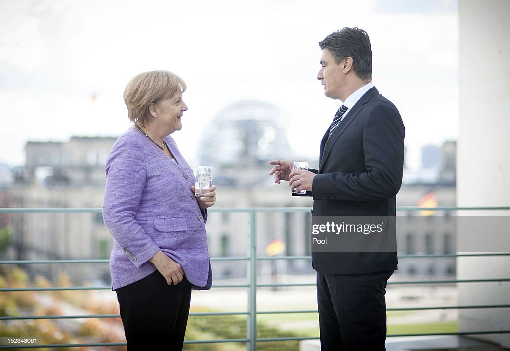In this photo provided by the German Government Press Office (BPA), German Chancellor <a gi-track='captionPersonalityLinkClicked' href=/galleries/search?phrase=Angela+Merkel&family=editorial&specificpeople=202161 ng-click='$event.stopPropagation()'>Angela Merkel</a> speaks with Croatian Prime Minister <a gi-track='captionPersonalityLinkClicked' href=/galleries/search?phrase=Zoran+Milanovic&family=editorial&specificpeople=4663917 ng-click='$event.stopPropagation()'>Zoran Milanovic</a> during a meeting in the German Chancellery on September 19, 2012 in Berlin, Germany.