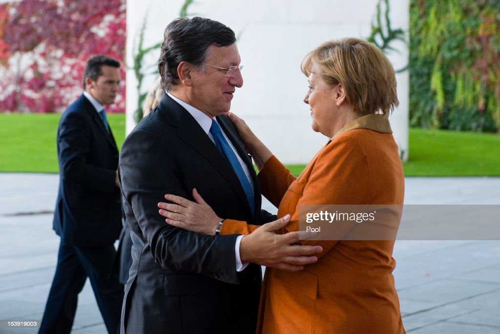 In this photo provided by the German Government Press Office (BPA), German Chancellor <a gi-track='captionPersonalityLinkClicked' href=/galleries/search?phrase=Angela+Merkel&family=editorial&specificpeople=202161 ng-click='$event.stopPropagation()'>Angela Merkel</a> greets President of the European Commission <a gi-track='captionPersonalityLinkClicked' href=/galleries/search?phrase=Jose+Manuel+Barroso&family=editorial&specificpeople=551196 ng-click='$event.stopPropagation()'>Jose Manuel Barroso</a> at the chancellery on October 11, 2012 in Berlin, Germany. Economic institutes in Germany have voiced their concerns over the European Central Bank's latest proposals for combatting the european economic crisis and have halved their growth forecasts for the German economy in the coming year.