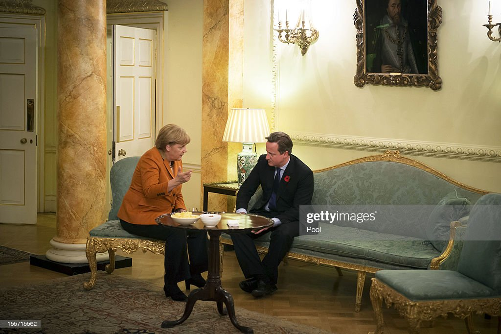 In this photo provided by the German Government Press Office (BPA), German Chancellor <a gi-track='captionPersonalityLinkClicked' href=/galleries/search?phrase=Angela+Merkel&family=editorial&specificpeople=202161 ng-click='$event.stopPropagation()'>Angela Merkel</a> and British Prime Minister <a gi-track='captionPersonalityLinkClicked' href=/galleries/search?phrase=David+Cameron+-+Politician&family=editorial&specificpeople=227076 ng-click='$event.stopPropagation()'>David Cameron</a> talk during a bilateral meeting at 10 Downing Street on November 7, 2012 in London, England. Prime Minister Cameron and Chancellor Merkel are holding talks over increasing the European Union's seven year budget, with Britain treatening to block any deal that proposes increases at a forthcoming EU summit of member states.