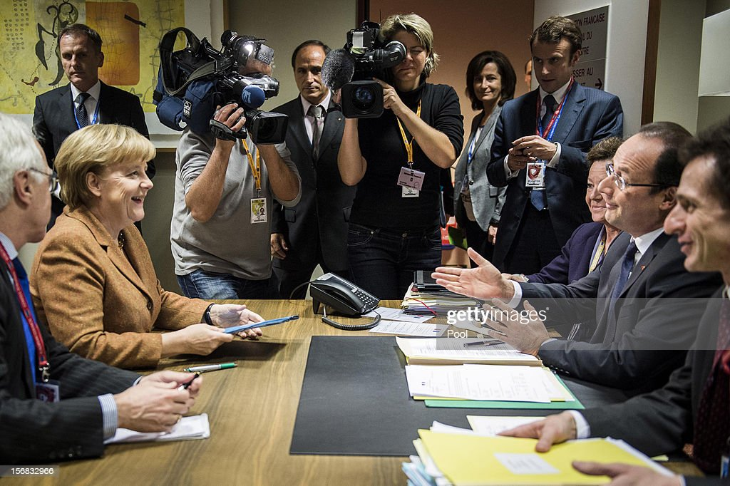 In this photo provided by the German Government Press Office (BPA), German Chancellor Angela Merklel holds talks with French President Francois Hollande, immediately prior to the special meeting of the European Council, on November 22, 2012 in Brussels, Belgium. The meeting is being attended by 27 EU Leaders and will focus on the ongoing financial crisis affecting large parts of the continent.
