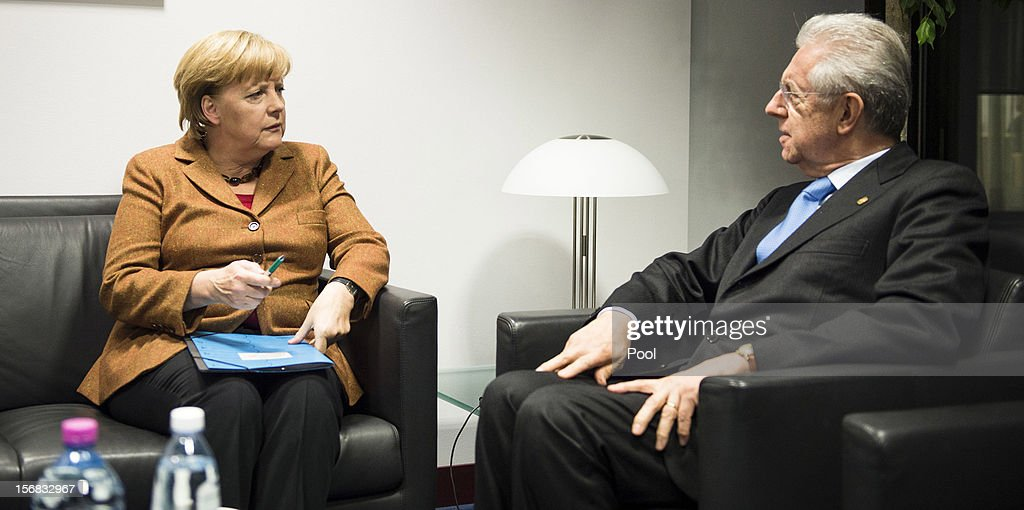 In this photo provided by the German Government Press Office (BPA), German Chancellor Angela Merklel holds talks with Italian Prime Minister <a gi-track='captionPersonalityLinkClicked' href=/galleries/search?phrase=Mario+Monti&family=editorial&specificpeople=632091 ng-click='$event.stopPropagation()'>Mario Monti</a>, immediately prior to the special meeting of the European Council, on November 22, 2012 in Brussels, Belgium. The meeting is being attended by 27 EU Leaders and will focus on the ongoing financial crisis affecting large parts of the continent.