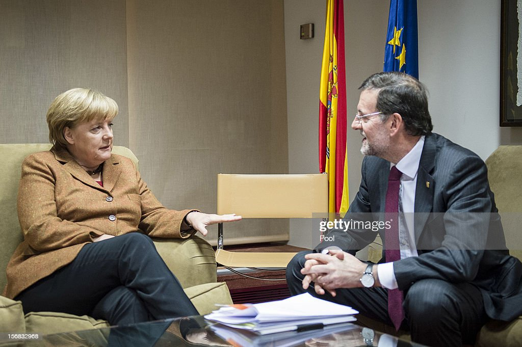 In this photo provided by the German Government Press Office (BPA), German Chancellor Angela Merklel holds talks with Spanish Prime Minister Mariano Rajoy, immediately prior to the special meeting of the European Council, on November 22, 2012 in Brussels, Belgium. The meeting is being attended by 27 EU Leaders and will focus on the ongoing financial crisis affecting large parts of the continent.
