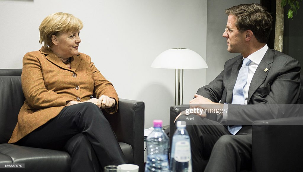 In this photo provided by the German Government Press Office (BPA), German Chancellor Angela Merklel holds talks with Dutch Prime Minister <a gi-track='captionPersonalityLinkClicked' href=/galleries/search?phrase=Mark+Rutte&family=editorial&specificpeople=4509362 ng-click='$event.stopPropagation()'>Mark Rutte</a>, immediately prior to the special meeting of the European Council, on November 22, 2012 in Brussels, Belgium. The meeting is being attended by 27 EU Leaders and will focus on the ongoing financial crisis affecting large parts of the continent.