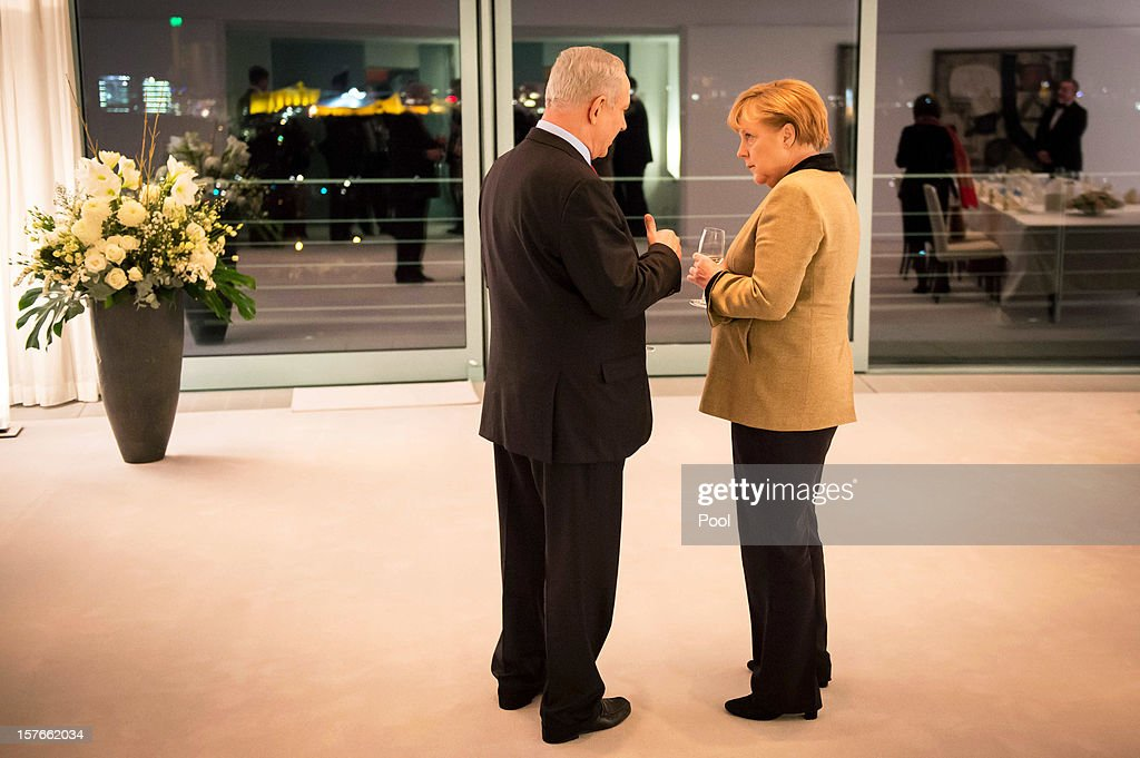 In this photo provided by the German Government Press Office (BPA), German Chancellor Angela Merkel and Israeli Prime Minister Benjamin Netanyahu talk at the start of their meeting of the German-Israeli government consultations at the Federal Chancellery on December 5, 2012 in Berlin, Germany.