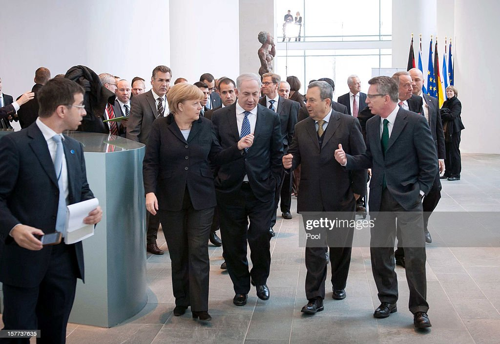 In this photo provided by the German Government Press Office (BPA), (L-R) German Chancellor Angela Merkel, Israeli Prime Minister Benjamin Netanyahu, Israeli Defense Minister Ehud Barak and German Defense Minister Thomas de Maiziere arrive at the Chancellery on December 6, 2012 in Berlin, Germany. The German and Israeli governments are meeting today in Berlin for German-Israeli government consultations.