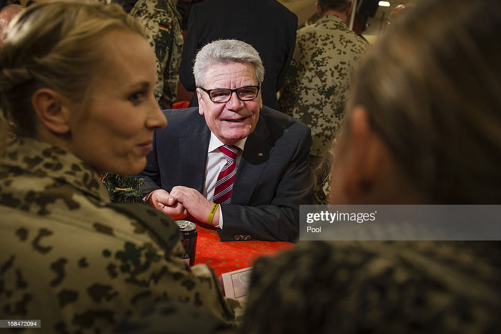 In this photo provided by the German Government Press Office (BPA), German President <a gi-track='captionPersonalityLinkClicked' href=/galleries/search?phrase=Joachim+Gauck&family=editorial&specificpeople=2077888 ng-click='$event.stopPropagation()'>Joachim Gauck</a> is seen speaking to German soldiers on a 'gratitude' visit to security forces at Camp Marmal on December 17, 2012 in Masar-i-Scharif in Afghanistan. The visit is Gauck's first to the region since taking office.