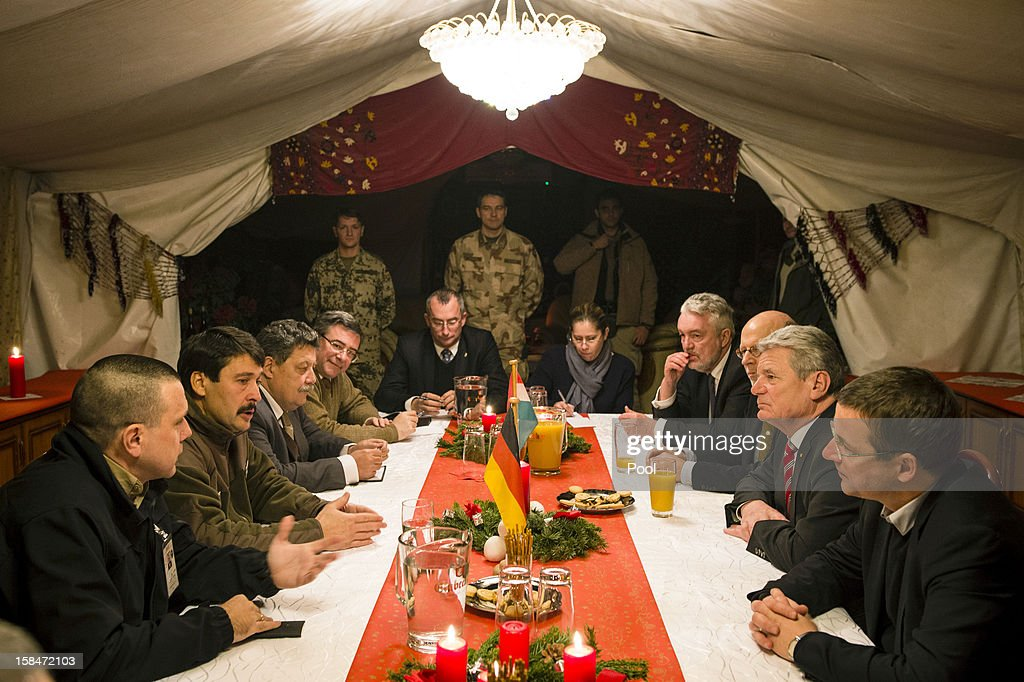 In this photo provided by the German Government Press Office (BPA), German President Joachim Gauck (2R) is seen on a 'gratitude' visit to security forces with Hungarian President Janos Ader (2L) at Camp Marmal on December 17, 2012 in Masar-i-Scharif in Afghanistan. The visit is Gauck's first to the region since taking office.