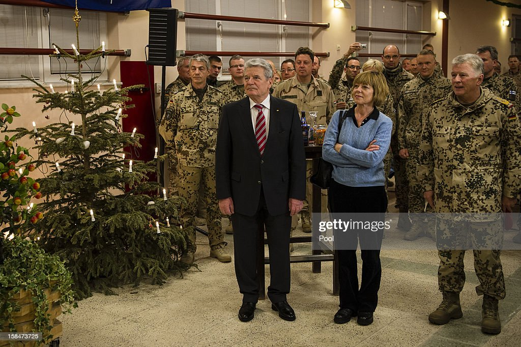 In this photo provided by the German Government Press Office (BPA), (L-R) German President <a gi-track='captionPersonalityLinkClicked' href=/galleries/search?phrase=Joachim+Gauck&family=editorial&specificpeople=2077888 ng-click='$event.stopPropagation()'>Joachim Gauck</a> is seen with his partner and journalist <a gi-track='captionPersonalityLinkClicked' href=/galleries/search?phrase=Daniela+Schadt&family=editorial&specificpeople=7055235 ng-click='$event.stopPropagation()'>Daniela Schadt</a> and Chief of Staff of the Bundeswehr Volker Wieker on a 'gratitude' visit to security forces at Camp Marmal on December 17, 2012 in Masar-i-Scharif in Afghanistan. The visit is Gauck's first to the region since taking office.
