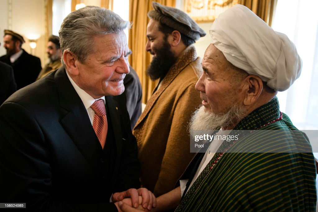 In this photo provided by the German Government Press Office (BPA), German President <a gi-track='captionPersonalityLinkClicked' href=/galleries/search?phrase=Joachim+Gauck&family=editorial&specificpeople=2077888 ng-click='$event.stopPropagation()'>Joachim Gauck</a> (L) talks to government representatives at the Presidential Palace on December 18, 2012 in Kabul, Afghanistan. The visit is Gauck's first to the region since taking office.