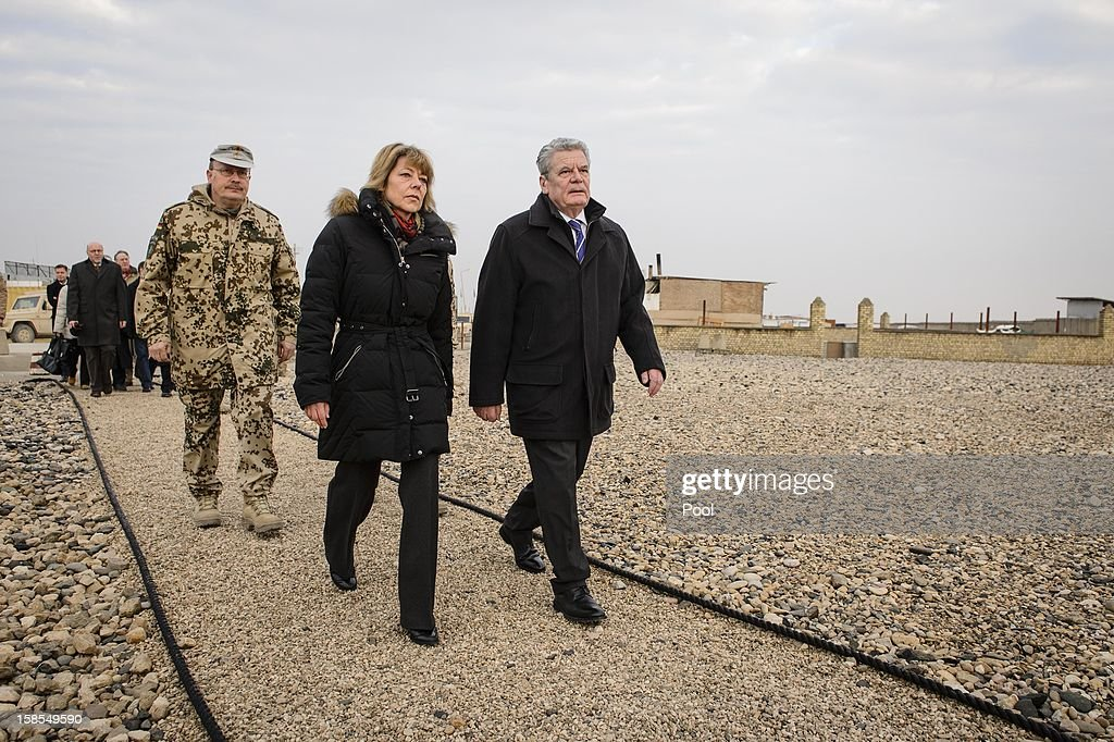 In this photo provided by the German Government Press Office (BPA), German President <a gi-track='captionPersonalityLinkClicked' href=/galleries/search?phrase=Joachim+Gauck&family=editorial&specificpeople=2077888 ng-click='$event.stopPropagation()'>Joachim Gauck</a>, his partner <a gi-track='captionPersonalityLinkClicked' href=/galleries/search?phrase=Daniela+Schadt&family=editorial&specificpeople=7055235 ng-click='$event.stopPropagation()'>Daniela Schadt</a> (C) and regional commander Major General Erich Pfeffer attend a memorial service to fallen soldiers at Camp Marmal on December 19, 2012 in Mazar-i-Sharif, Afghanistan. The visit is Gauck's first to the region since taking office during which he has held talks with Afghan president Hamid Karzai and government representatives.