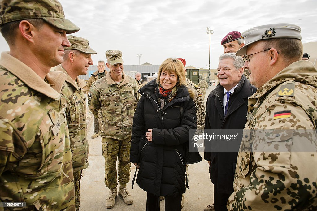 In this photo provided by the German Government Press Office (BPA), German President Joachim Gauck (2nd R), his partner Daniela Schadt (C) and regional commander Major General Erich Pfeffer (R) visit U.S troops from the 158th Aviation Regiment and the 1st Battalion, 211th Aviation Regiment staitioned at Camp Marmal on December 19, 2012 in Mazar-i-Sharif, Afghanistan. The visit is Gauck's first to the region since taking office during which he has held talks with Afghan president Hamid Karzai and government representatives.
