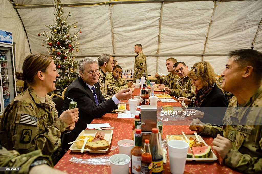 In this photo provided by the German Government Press Office (BPA), German President <a gi-track='captionPersonalityLinkClicked' href=/galleries/search?phrase=Joachim+Gauck&family=editorial&specificpeople=2077888 ng-click='$event.stopPropagation()'>Joachim Gauck</a> (2nd L) breakfasts with U.S. troops stationed at NATO base military Camp Marmal on December 19, 2012 in Mazar-i-Sharif, Afghanistan. Gauck's is on his first visit to the region since taking office, during which he has shown support for German troops stationed in the region and held talks with Afghan president Hamid Karzai and government representatives.