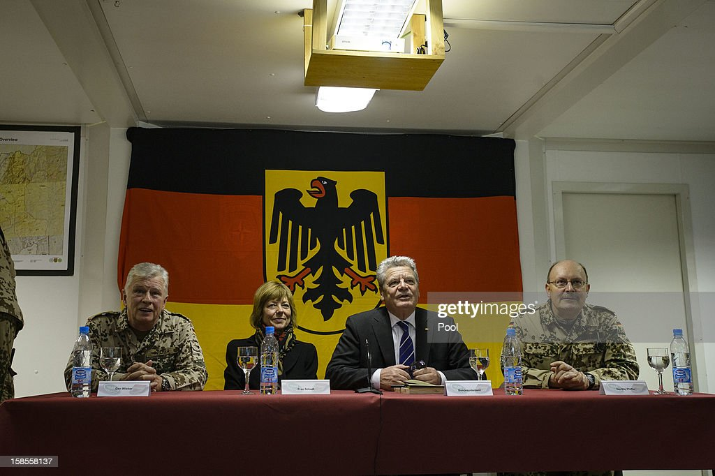 In this photo provided by the German Government Press Office (BPA), German President <a gi-track='captionPersonalityLinkClicked' href=/galleries/search?phrase=Joachim+Gauck&family=editorial&specificpeople=2077888 ng-click='$event.stopPropagation()'>Joachim Gauck</a> talks to German soldiers via video link to Operation Point North from the NATO Military base Camp Marmal as his partner <a gi-track='captionPersonalityLinkClicked' href=/galleries/search?phrase=Daniela+Schadt&family=editorial&specificpeople=7055235 ng-click='$event.stopPropagation()'>Daniela Schadt</a> (2L) and Commander of ISAF Regional Command - North, Erich Pfeffer (R) look on on December 19, 2012 in Mazar-i-Sharif, Afghanistan. The visit is Gauck's first to the region since taking office during which he has held talks with Afghan president Hamid Karzai and government representatives.