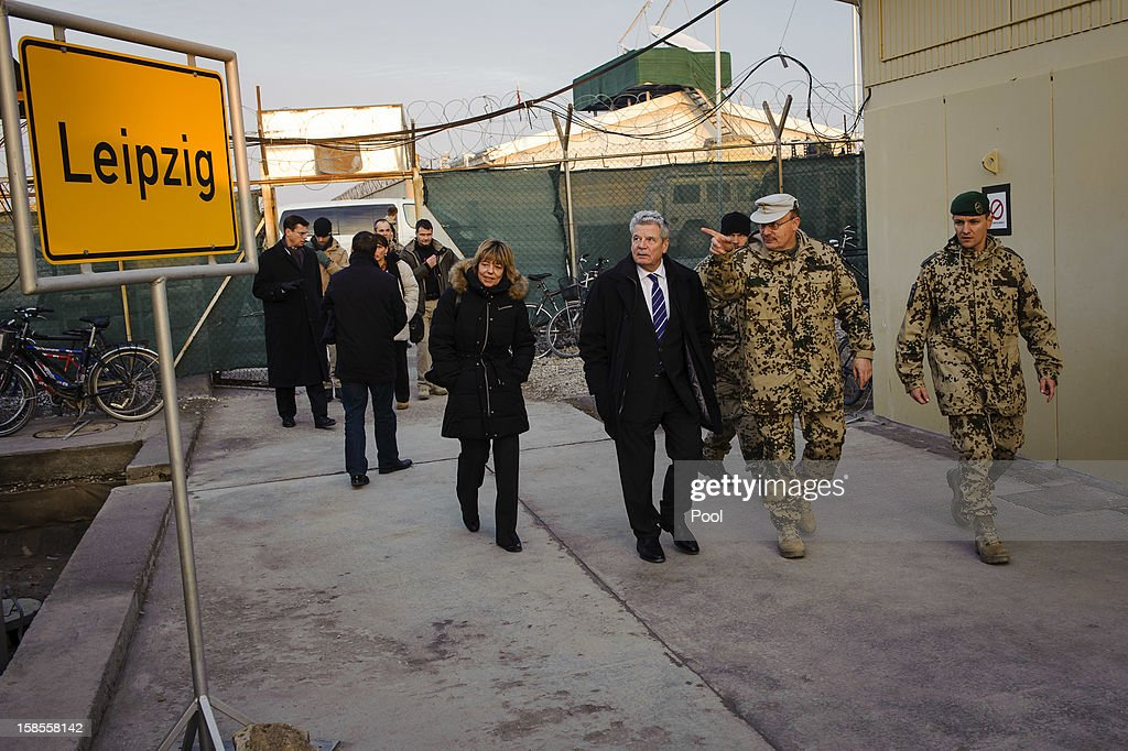 In this photo provided by the German Government Press Office (BPA), German President Joachim Gauck and his partner Daniela Schadt are seen walking past a sign for Leipzig with Commander of ISAF Regional Command - North, Erich Pfeffer (2R) during a tour of NATO Military base Camp Marmal on December 19, 2012 in Mazar-i-Sharif, Afghanistan. The visit is Gauck's first to the region since taking office during which he has held talks with Afghan president Hamid Karzai and government representatives.