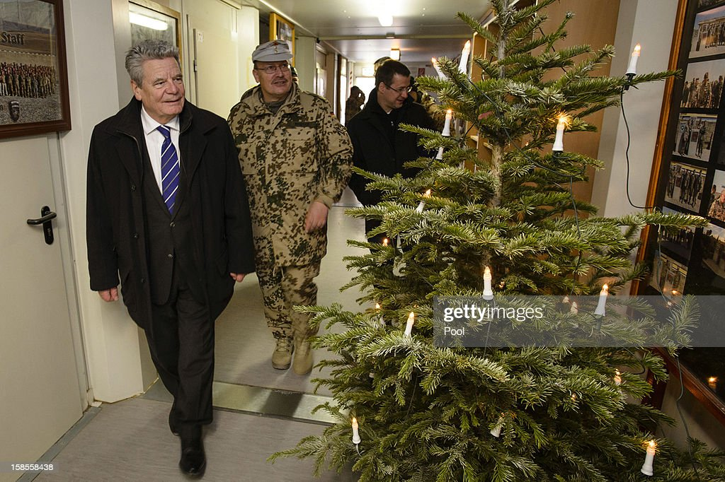 In this photo provided by the German Government Press Office (BPA), German President <a gi-track='captionPersonalityLinkClicked' href=/galleries/search?phrase=Joachim+Gauck&family=editorial&specificpeople=2077888 ng-click='$event.stopPropagation()'>Joachim Gauck</a> (L) and Commander of ISAF Regional Command - North, Erich Pfeffer (R) walk past a Christmas tree during a tour of NATO Military base Camp Marmal on December 19, 2012 in Mazar-i-Sharif, Afghanistan. The visit is Gauck's first to the region since taking office during which he has held talks with Afghan president Hamid Karzai and government representatives.