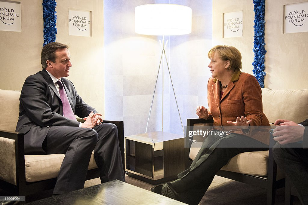 In this photo provided by the German Government Press Office (BPA), German Chancellor <a gi-track='captionPersonalityLinkClicked' href=/galleries/search?phrase=Angela+Merkel&family=editorial&specificpeople=202161 ng-click='$event.stopPropagation()'>Angela Merkel</a> (R) talks with British Prime Minister <a gi-track='captionPersonalityLinkClicked' href=/galleries/search?phrase=David+Cameron+-+Politician&family=editorial&specificpeople=227076 ng-click='$event.stopPropagation()'>David Cameron</a> at The World Economic Forum 2013 on January 24, 2013 in Davos, Switzerland. The annueal event runs for five days and is attended by world leaders, banking industry representatives and policy makers. The topic of Europe was expected to dominate talks today after yesterdays landmark speech by Prime Minister <a gi-track='captionPersonalityLinkClicked' href=/galleries/search?phrase=David+Cameron+-+Politician&family=editorial&specificpeople=227076 ng-click='$event.stopPropagation()'>David Cameron</a>, in which he paved the way for a historic referendum on Britains membership to the European Union.