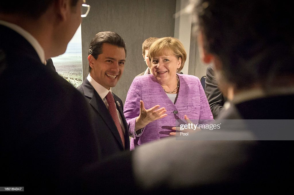 In this photo provided by the German Government Press Office (BPA), German Chancellor <a gi-track='captionPersonalityLinkClicked' href=/galleries/search?phrase=Angela+Merkel&family=editorial&specificpeople=202161 ng-click='$event.stopPropagation()'>Angela Merkel</a> and Mexican's President <a gi-track='captionPersonalityLinkClicked' href=/galleries/search?phrase=Enrique+Pena+Nieto&family=editorial&specificpeople=5957985 ng-click='$event.stopPropagation()'>Enrique Pena Nieto</a> chat after their meeting during the CELAC-EU Summit on January 27, 2013 in Santiago de Chile, Chile. At the first summit of the Community of Latin American and Caribbean States (CELAC) with the European Union (EU) high-level delegations from about 60 countries participate.