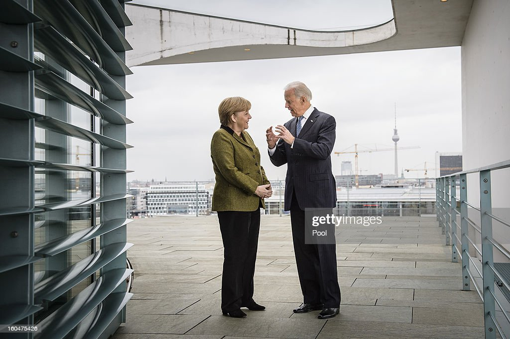 In this photo provided by the German Government Press Office (BPA) German Chancellor <a gi-track='captionPersonalityLinkClicked' href=/galleries/search?phrase=Angela+Merkel&family=editorial&specificpeople=202161 ng-click='$event.stopPropagation()'>Angela Merkel</a> (L) speaks with US Vice President Joe Biden at the start of their meeting at the Chancellery on February 01, 2013 in in Berlin, Germany. The Munich Security Conference is attended by international security policy decision-makers from around the world to engage in debate on current and future security issues faced globally.